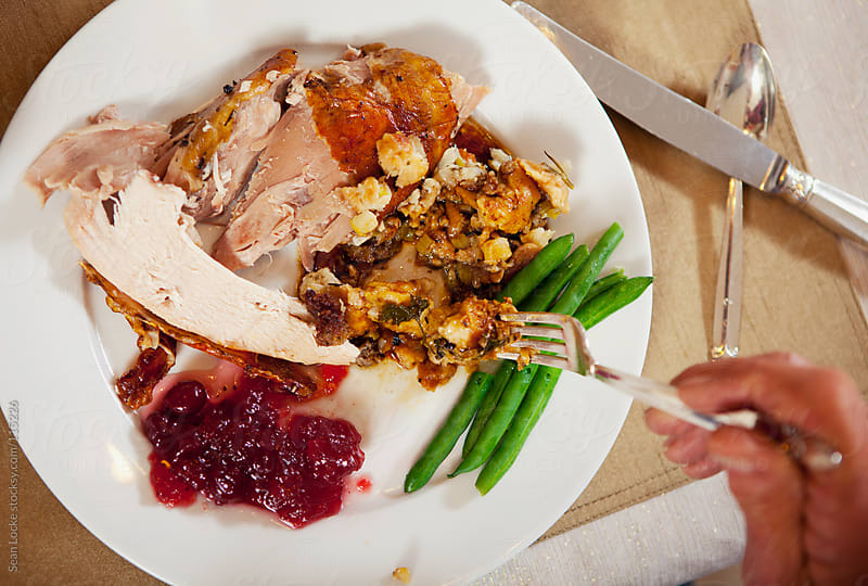 Thanksgiving: Eating a Plate of Thanksgiving Dinner by Sean Locke for Stocksy United
