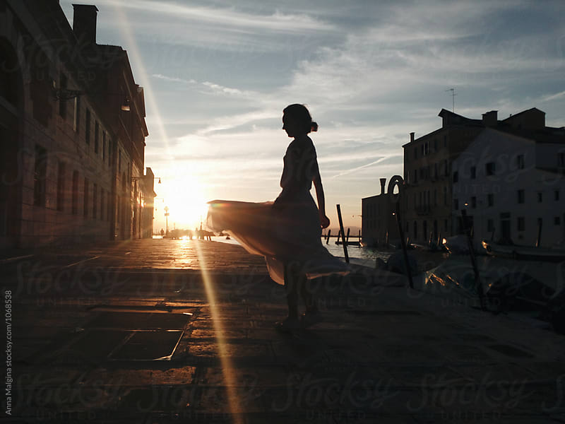 A woman dancing on sunset by Anna Malgina for Stocksy United