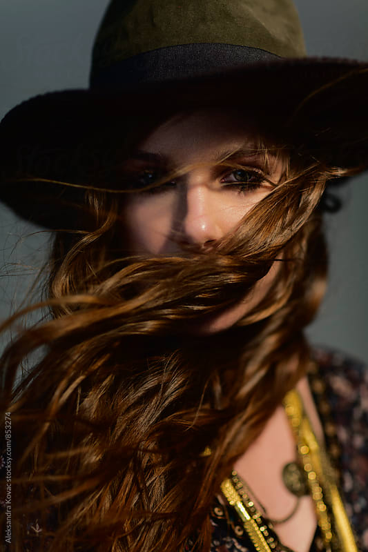 Portrait of a woman with a hat by Aleksandra Kovac for Stocksy United