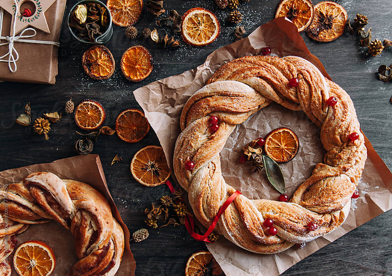 Cinnamon wreaths with dried oranges by Nataša Mandić for Stocksy United