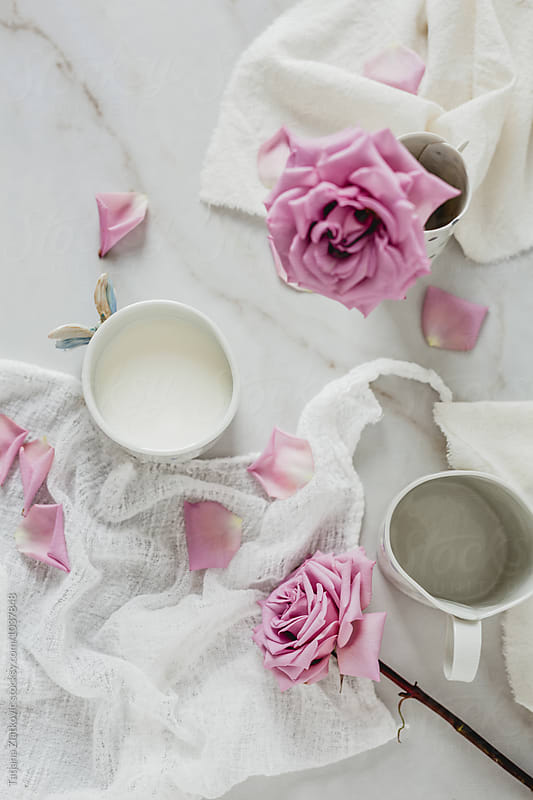 Artistic mugs with milk and flowers by Tatjana Ristanic for Stocksy United