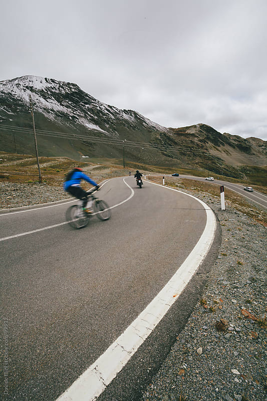 Cyclist on a mountain road by Davide Illini for Stocksy United
