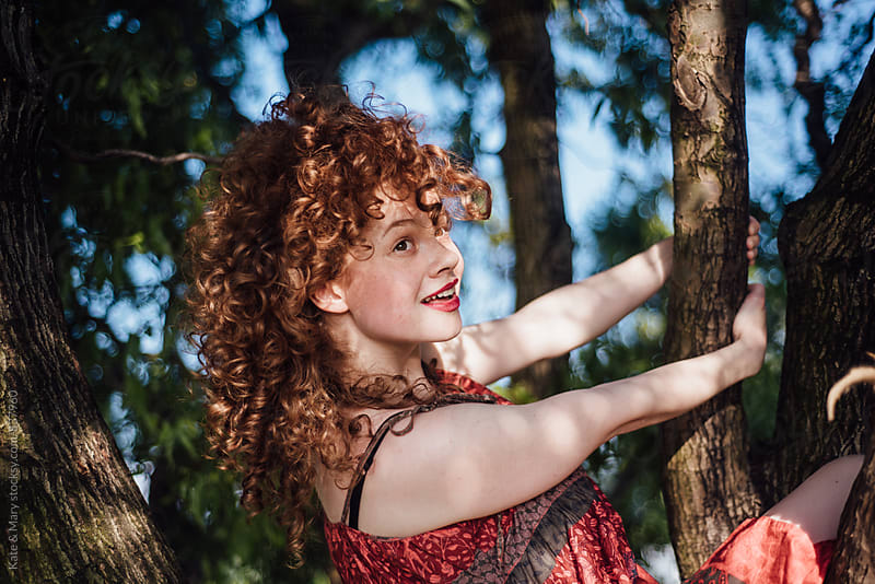 Portrait of beautiful smiling ginger woman by Katarina Simovic for Stocksy United
