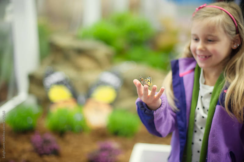 Young Girl in A Butterfly Garden by Leigh Love for Stocksy United