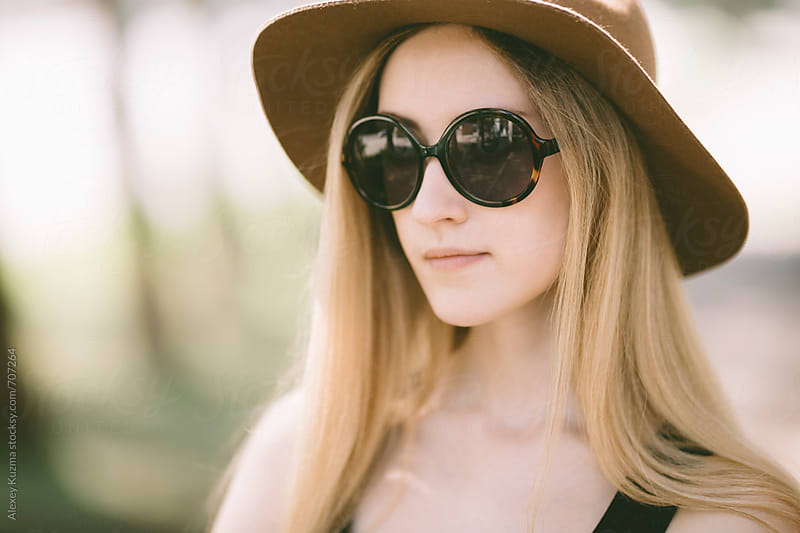 portrait of real young woman with vintage sunglasses  by Vesna for Stocksy United