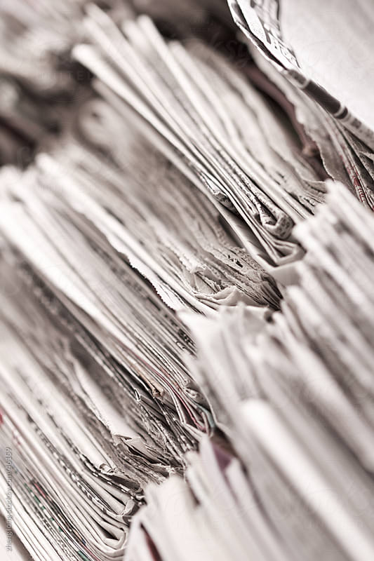 close up of newspaper by zheng long for Stocksy United