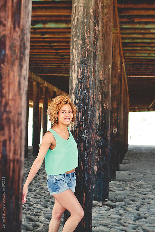 Young Mixed Race Girl Under a Pier by Jayme Burrows for Stocksy United