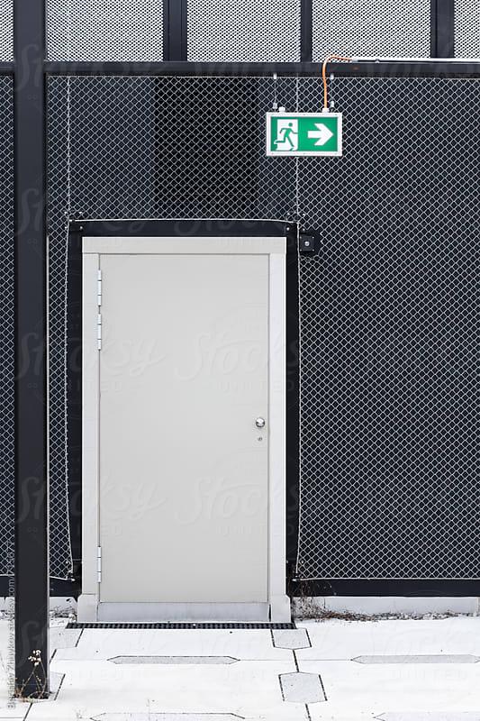 Exit signs in industrial building by Borislav Zhuykov for Stocksy United