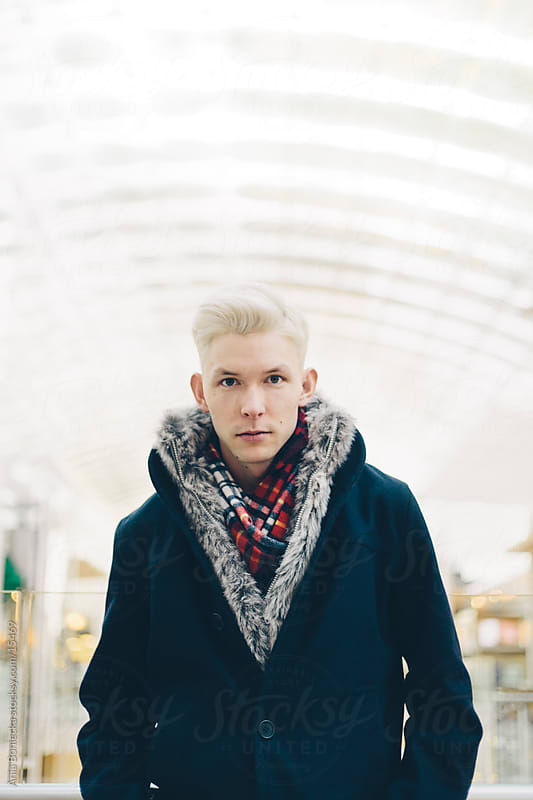 A young man dressed for the winter cold by Ania Boniecka for Stocksy United
