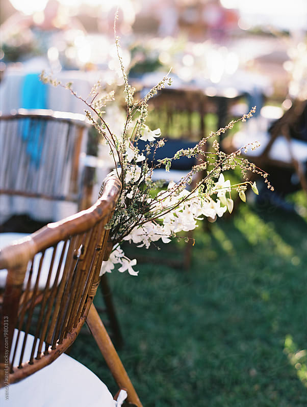 floral chair decoration at wedding by wendy laurel for Stocksy United