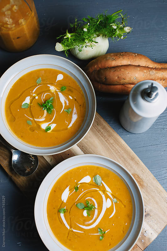 Roasted sweet potato and fennel soup with yogurt dressing. by Darren Muir for Stocksy United