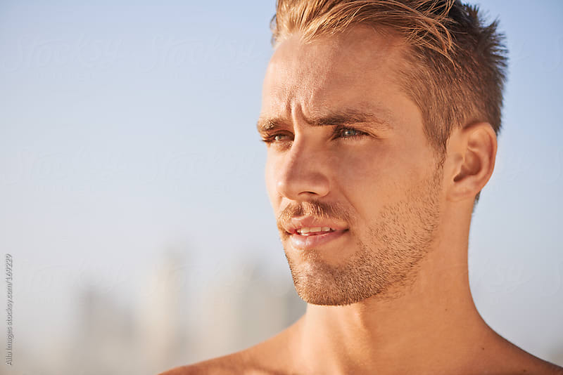 Portrait of Gorgeous Guy on the beach by Aila Images for Stocksy United