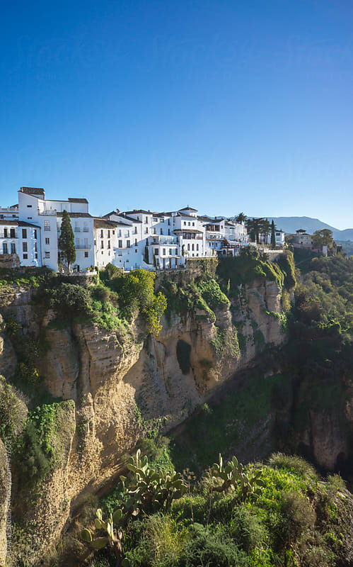 Houses on the edge of the cliff in Ronda by ACALU Studio for Stocksy United
