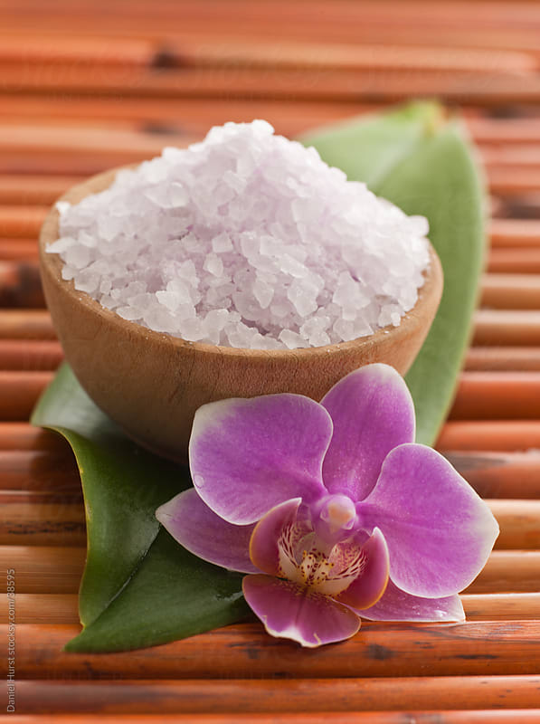 Bath salts on leaf with tropical orchid by Daniel Hurst for Stocksy United