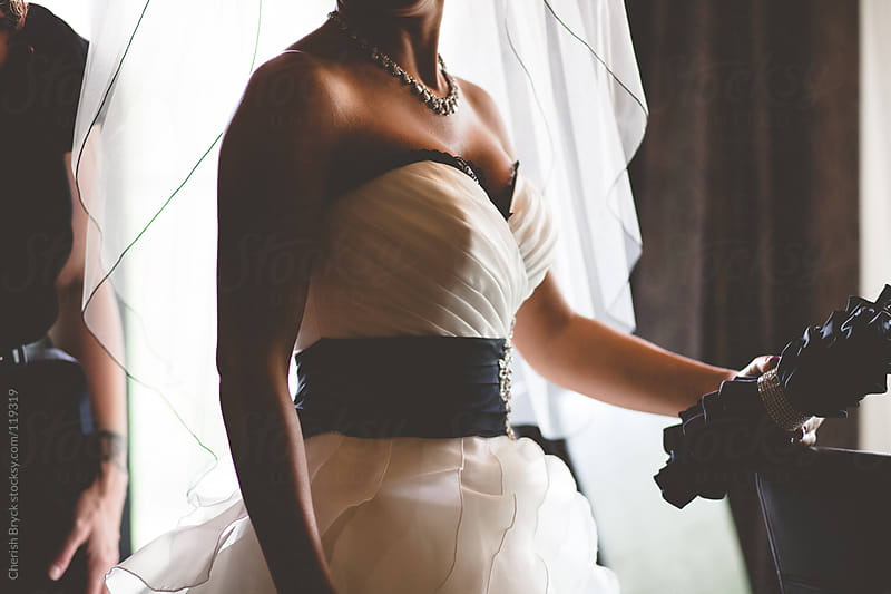 A Bride waits in her gown. by Cherish Bryck for Stocksy United
