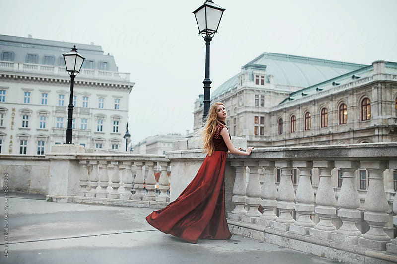 Fashionable young woman in a red dress by Jovana Rikalo for Stocksy United