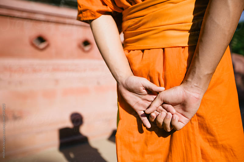 Detail of hands of a Buddhist monk by michela ravasio for Stocksy United