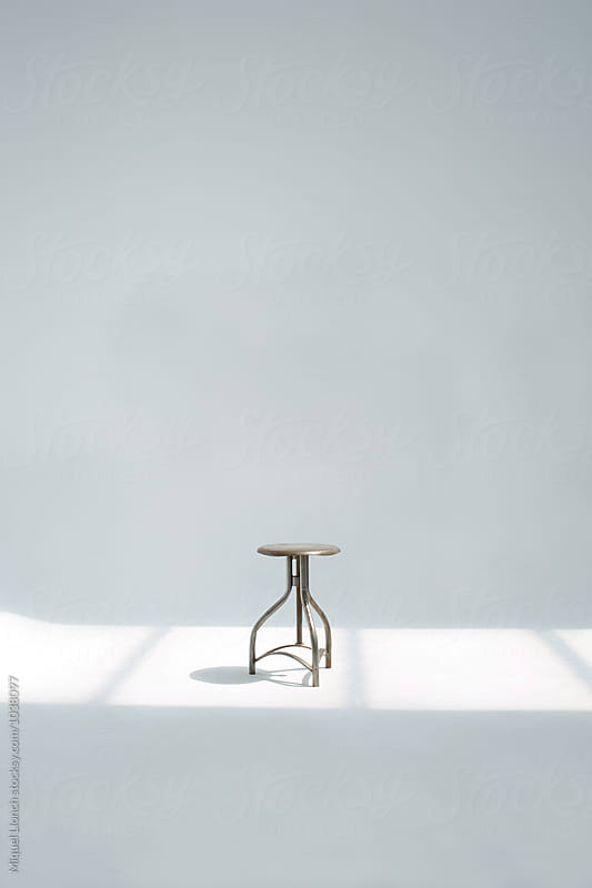 One metallic and adjustable stool in the studio by Miquel Llonch for Stocksy United