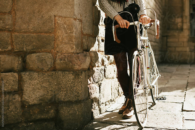 Closeup of a woman with her vintage bicycle on the street. by BONNINSTUDIO for Stocksy United