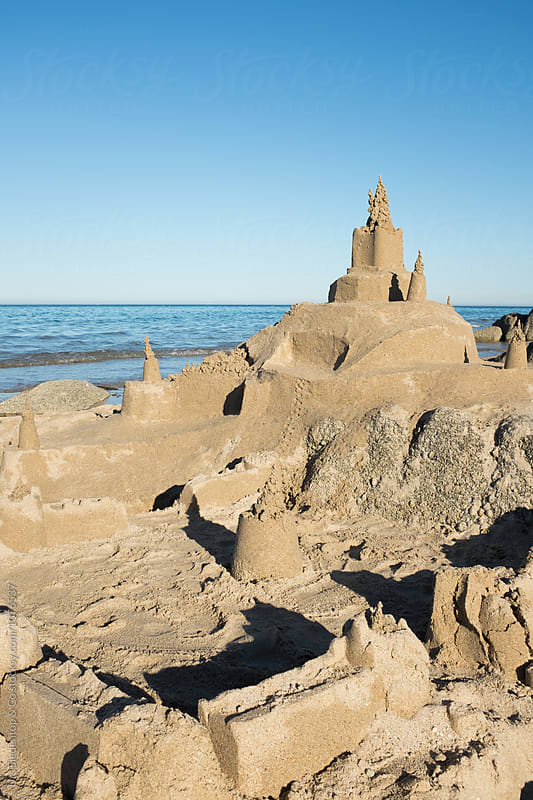 Sandcastle on beach in France by Urs Siedentop & Co for Stocksy United