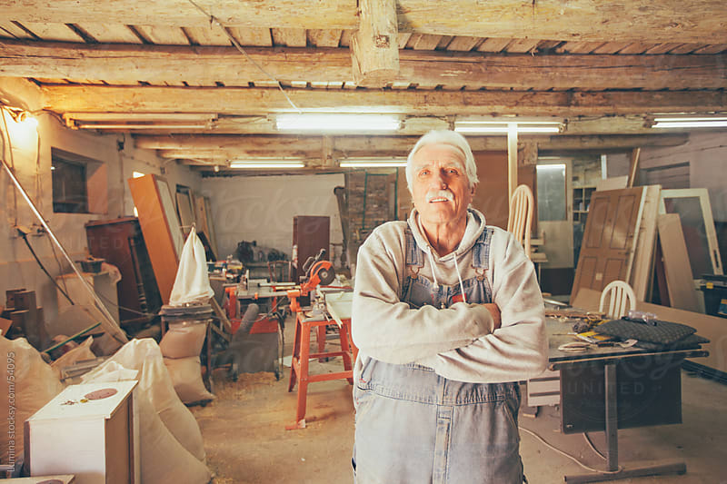 Elderly Carpenter at His Workshop by Lumina for Stocksy United