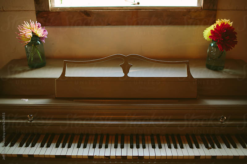 Flowers on a piano by Jeff Marsh for Stocksy United