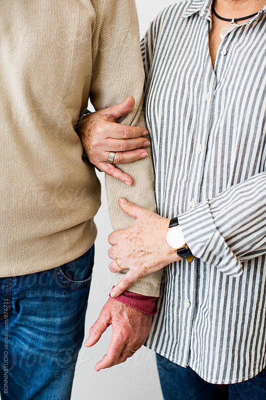 Closeup of an elderly couple embracing together. by BONNINSTUDIO for Stocksy United