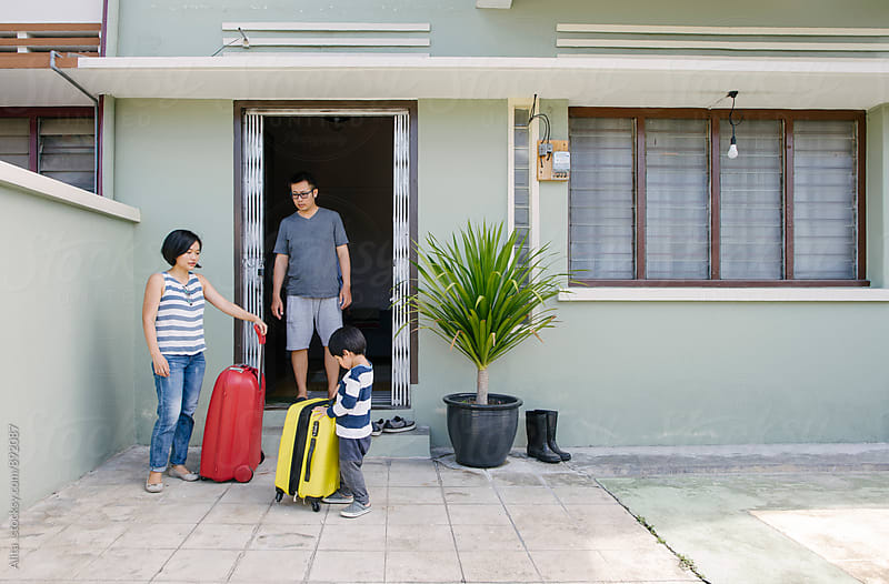 Family leaving home for a trip by Alita Ong for Stocksy United