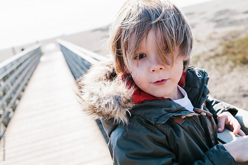 Portrait of a boy with a winter coat on by Melanie Riccardi for Stocksy United