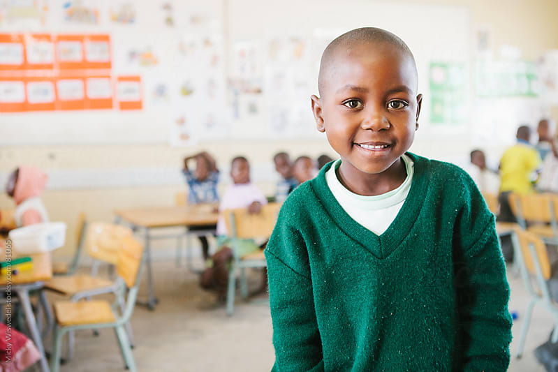 Cute African school girl in a classroom by Micky Wiswedel for Stocksy United