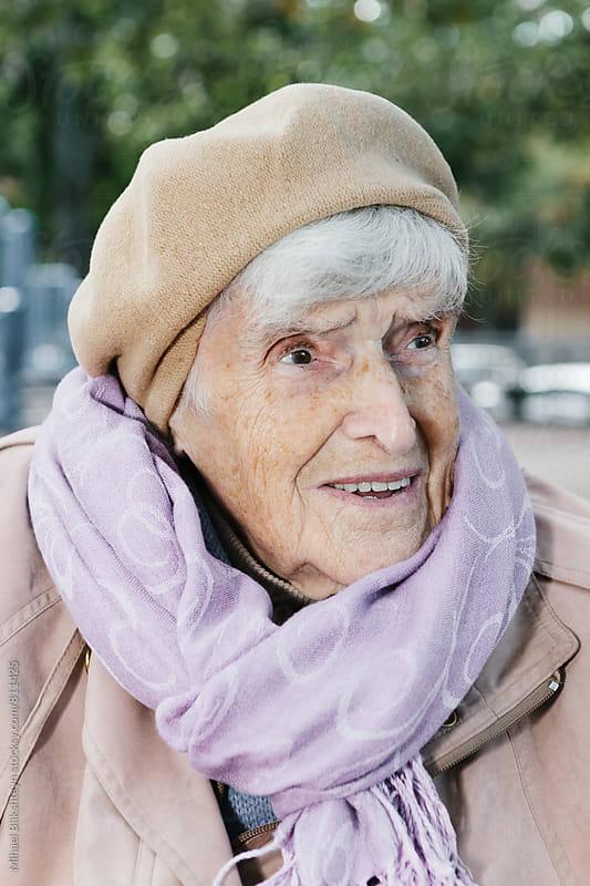 Portrait of an elderly woman in the 90s outside in the park by Mihael Blikshteyn for Stocksy United