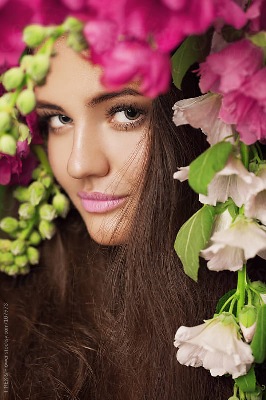 Beautiful portrait of a girl with flowers by T-REX & Flower for Stocksy United