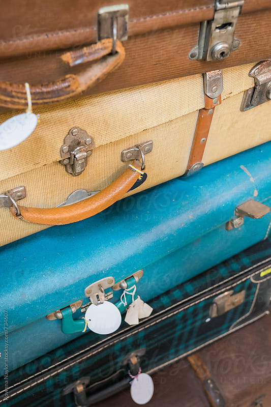 Detail of stacked vintage luggage by Rowena Naylor for Stocksy United