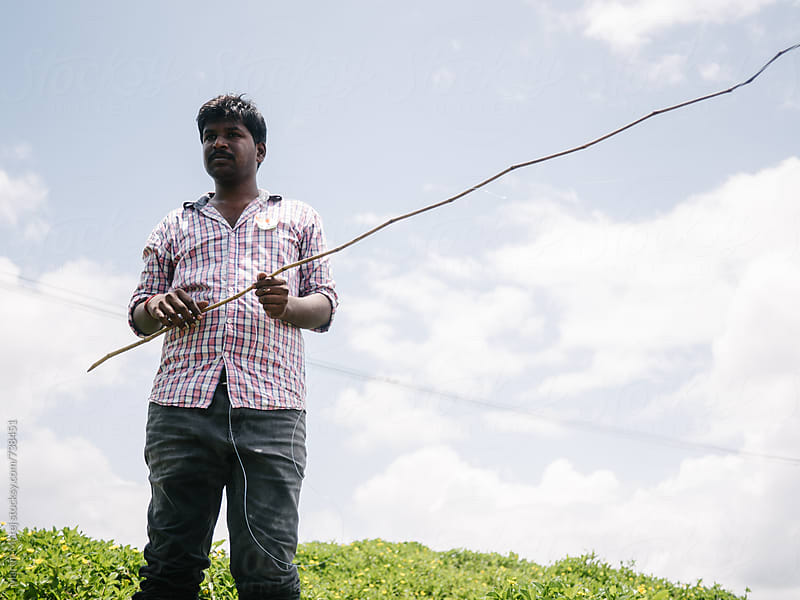 Indian fisherman with his fishing pole by Martin Matej for Stocksy United