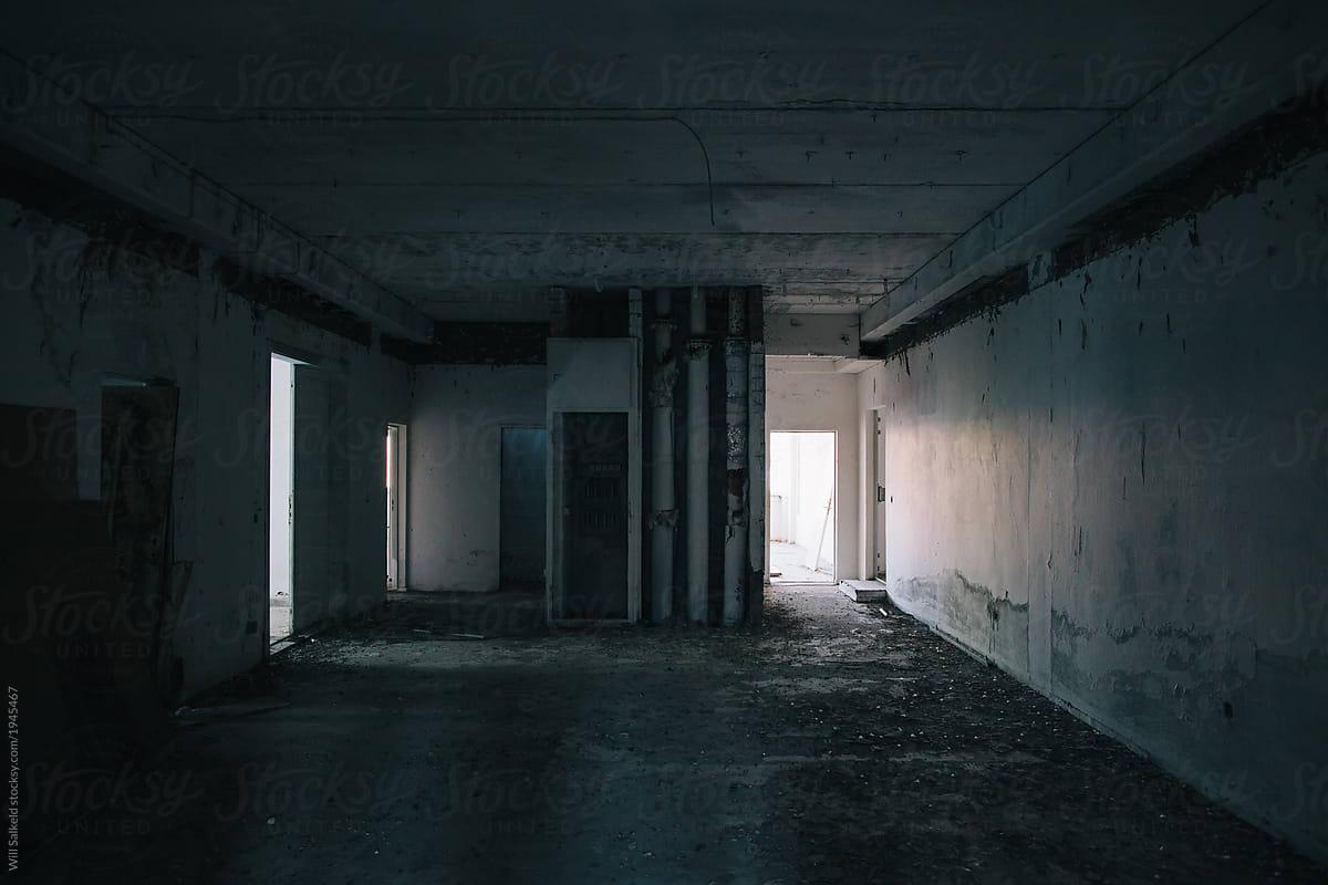 Dark abandoned building room by Will Salkeld - Stocksy United