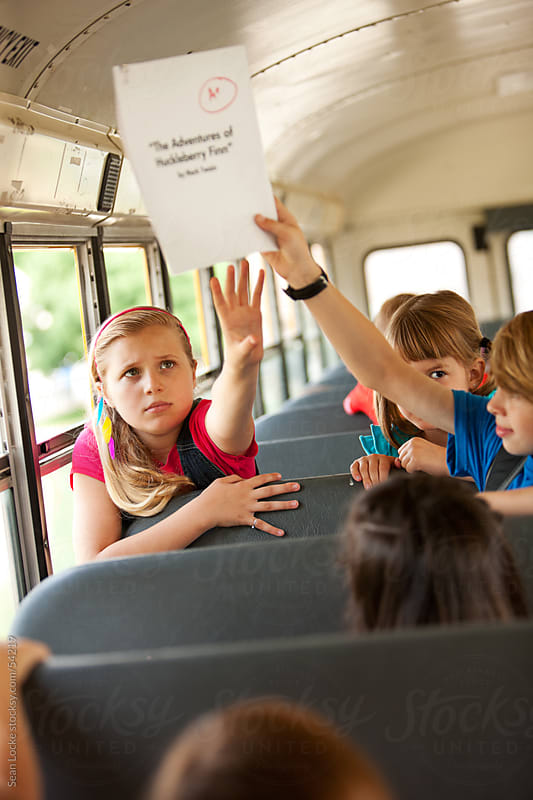 School Bus: Bullying A Girl on the Bus by Sean Locke for Stocksy United