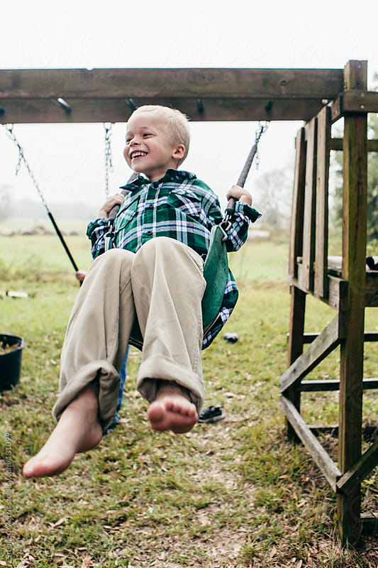 Boy on Swing by Stephen Morris for Stocksy United