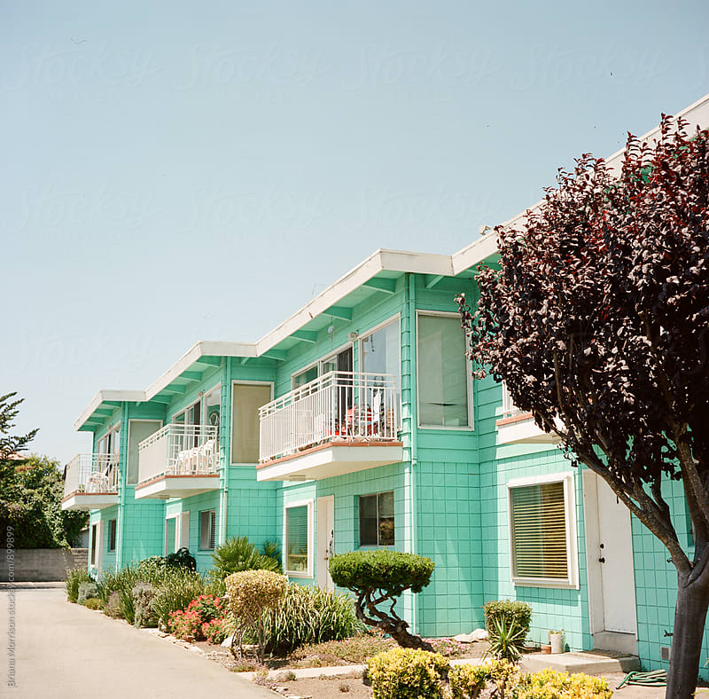 Bright Aqua Apartment Buildings in Sunny California by Briana Morrison for Stocksy United