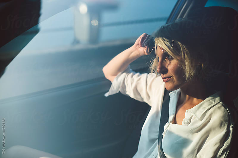 Young blonde girl in the car by GIC for Stocksy United