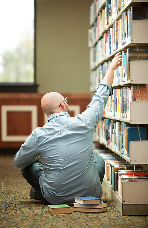 Library: Adult Student Selecting Another Book by Sean Locke for Stocksy United