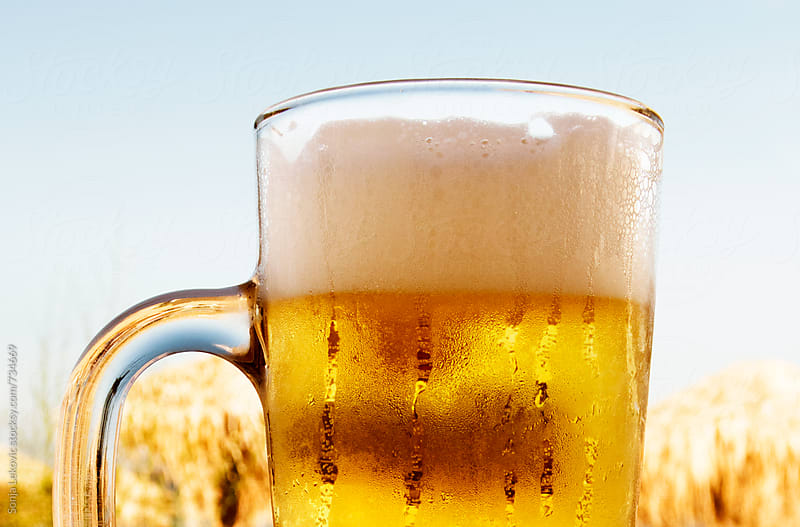 glass of beer outdoor closeup by Sonja Lekovic for Stocksy United