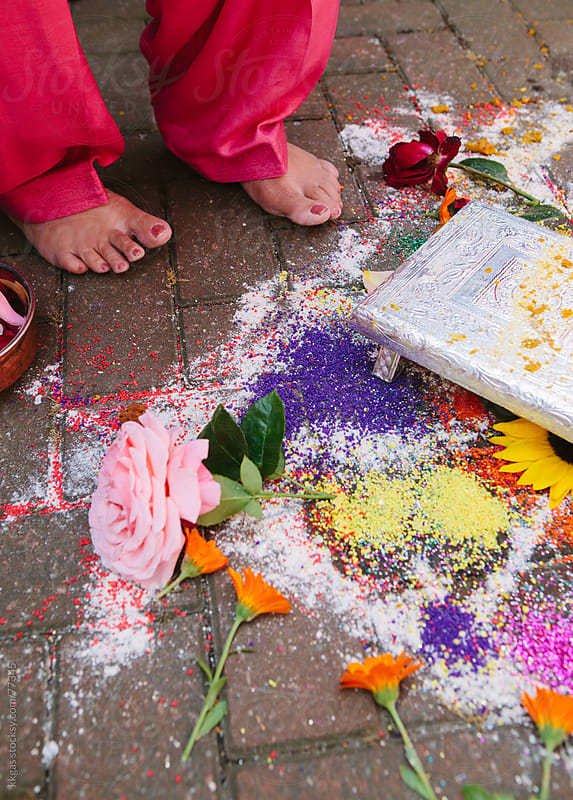 Mother of the groom jumps over the Rangoli during a sikh wedding by kkgas for Stocksy United