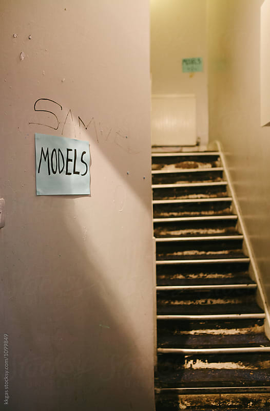 Staircase with a handwritten sign that says 'Models' next to a staircase by kkgas for Stocksy United
