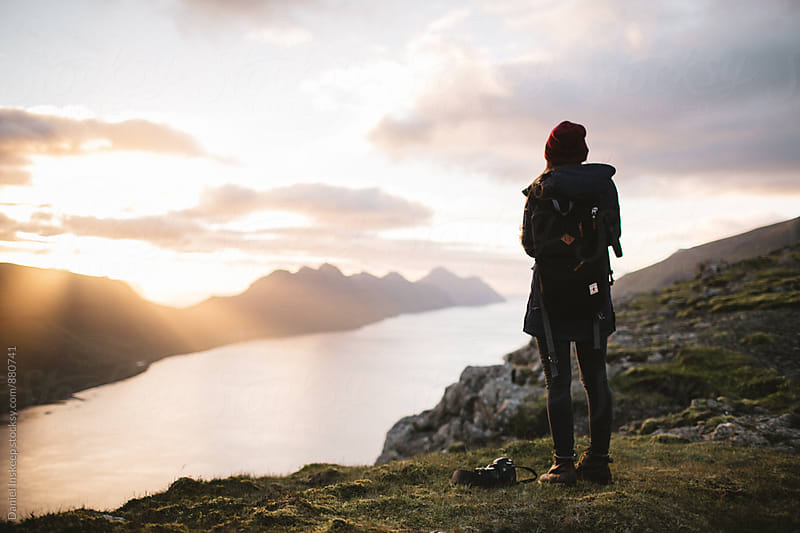 Woman on an Island Overlook at Sunset by Daniel Inskeep for Stocksy United