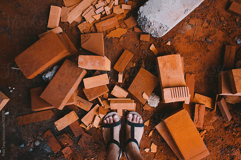 Messy orange bricks on the ground by Nabi Tang for Stocksy United