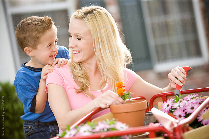 Planting: Little Boy Learns to Garden with Mother by Sean Locke for Stocksy United