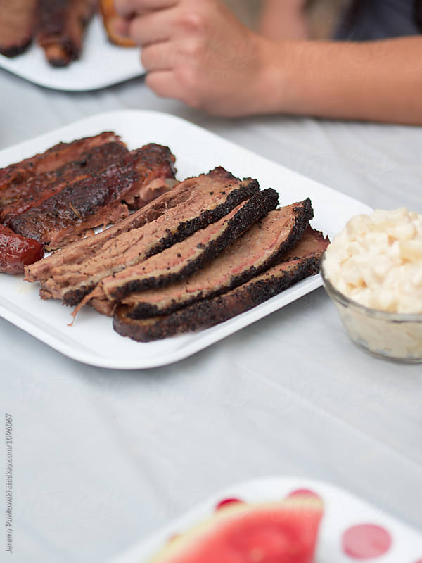 Smoked brisket and ribs on plate by Jeremy Pawlowski for Stocksy United