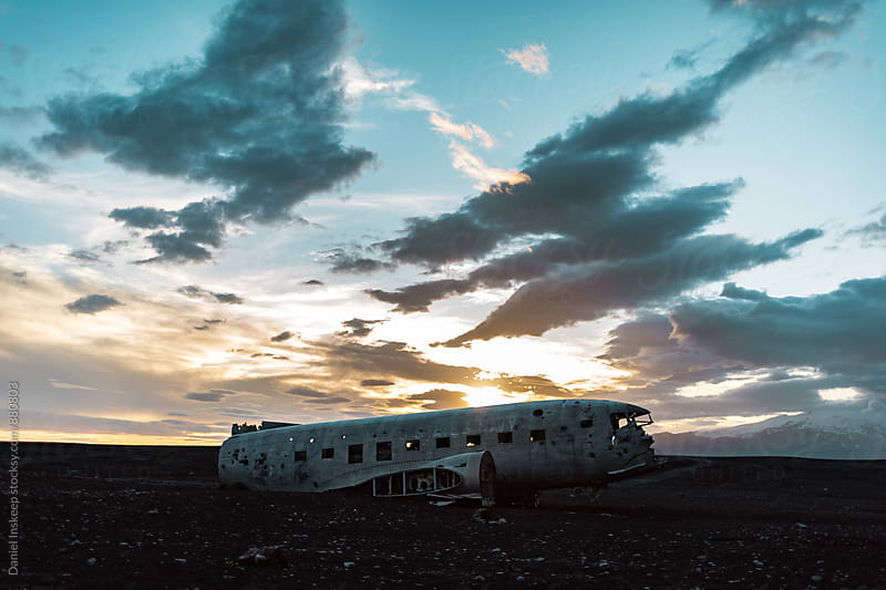 Plane Wreckage at Black Sand Beach in Iceland by Daniel Inskeep for Stocksy United