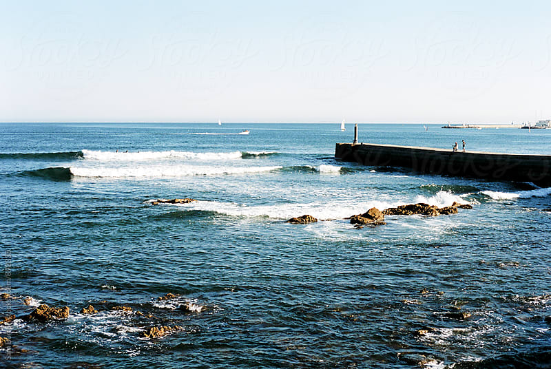 Waves roll in at Cascais in Portugal by Sam Burton for Stocksy United