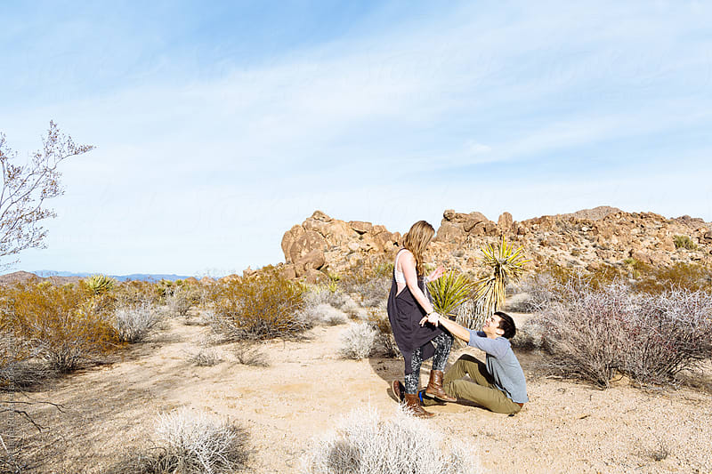 Couple having fun in desert by Melanie Riccardi for Stocksy United